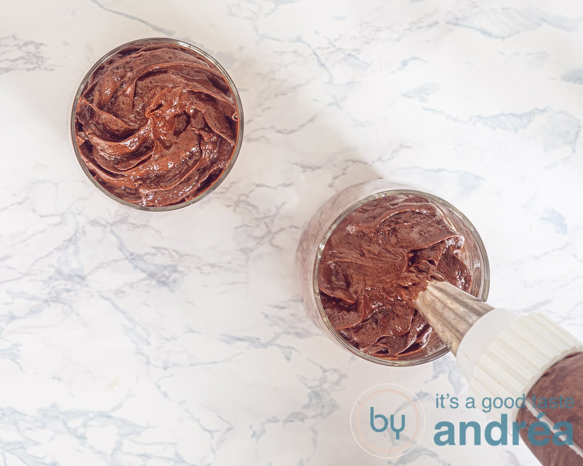 Pipe dark chocolate mousse in a glass