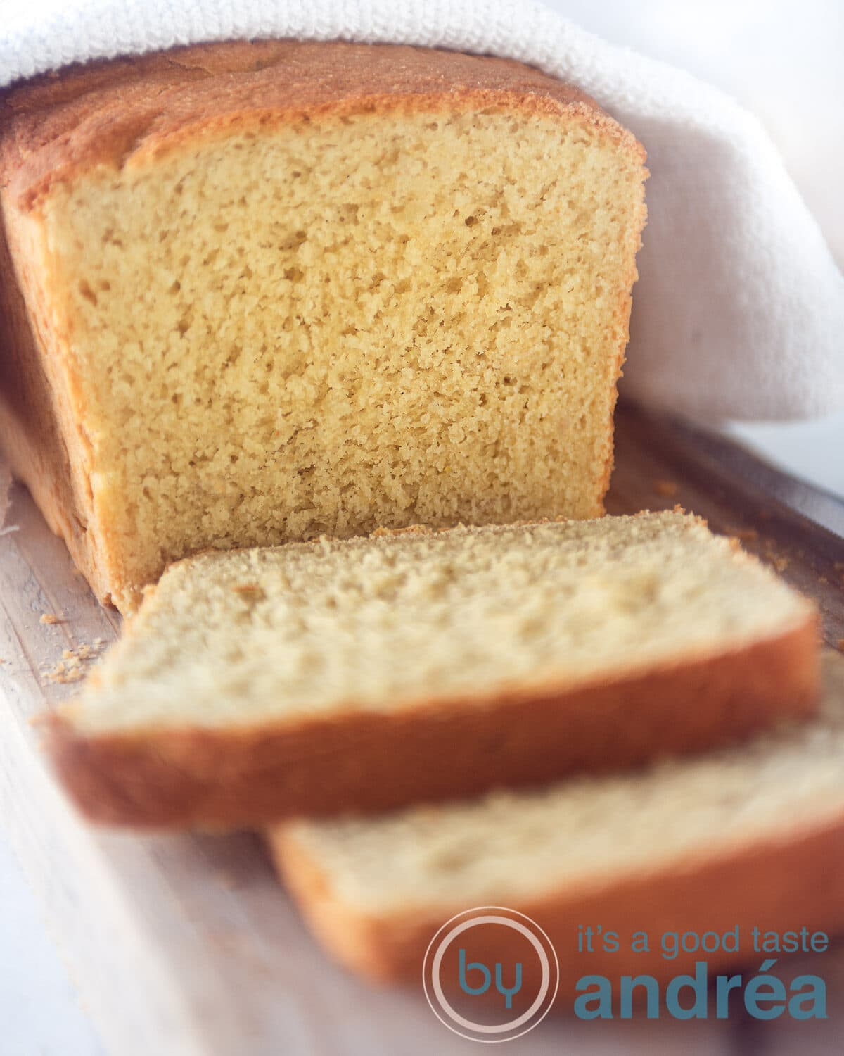 cornbread loaf and some slices cut of on a white plate