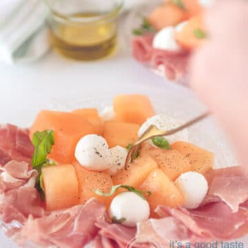 Salad with melon, ham and mozzarella on a plate