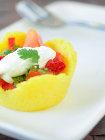 polenta cup with tomato filling on a plate