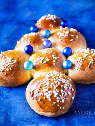 Sweet Christmas buns on a blue cloth