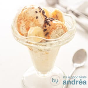 A square photo with a glass filled with banana chocolate ice cream and sauce