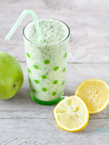 a glass with Healthy smoothie and an apple and lemon