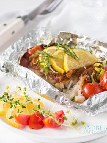 Cod filet into aluminum foil