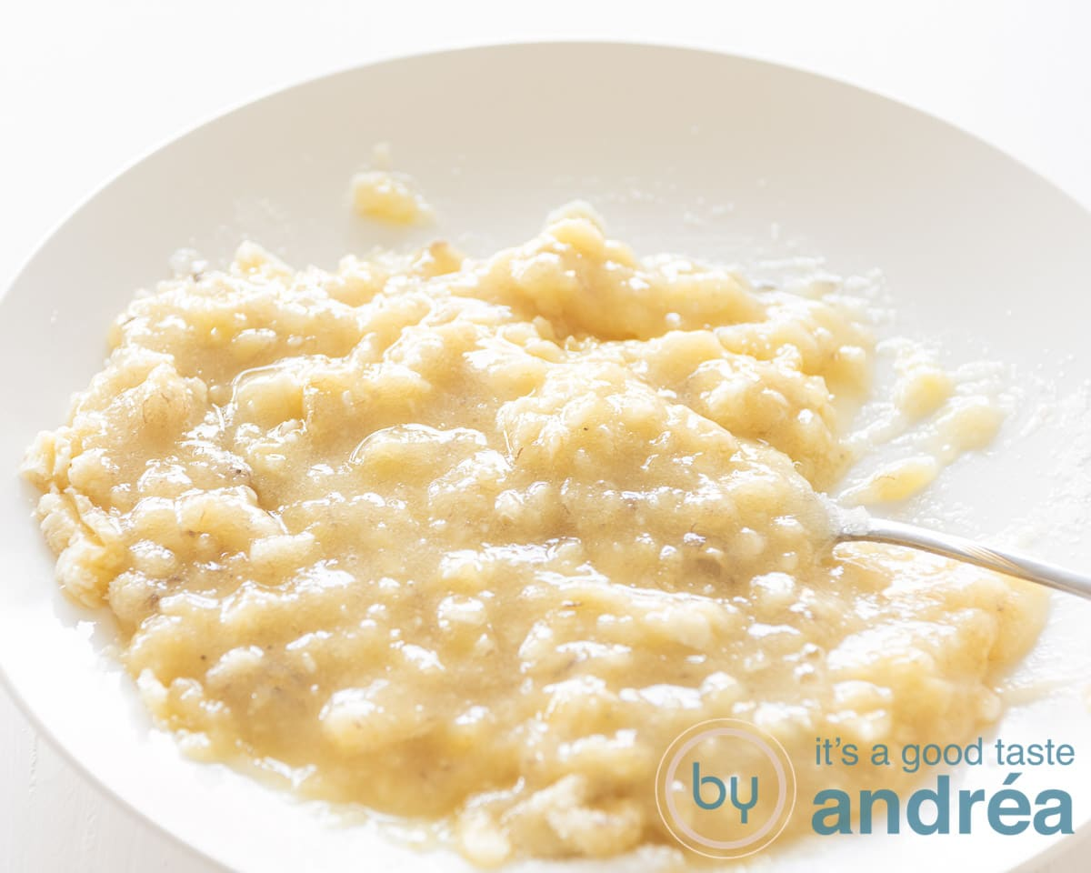 A white plate with mashed bananas