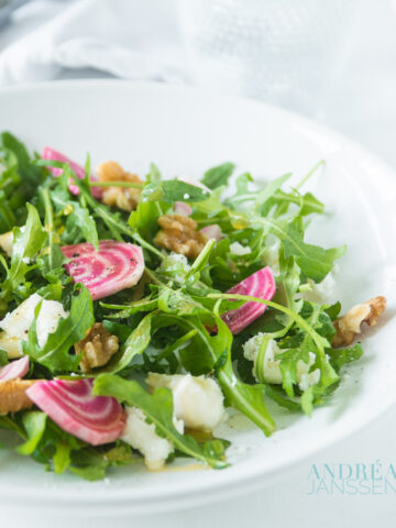 a plate with arugula salad with beets