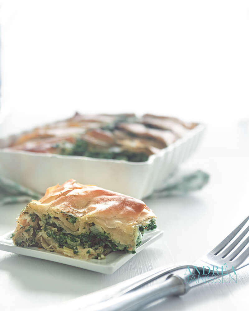 spanakopita in an oven casserole and on a plate