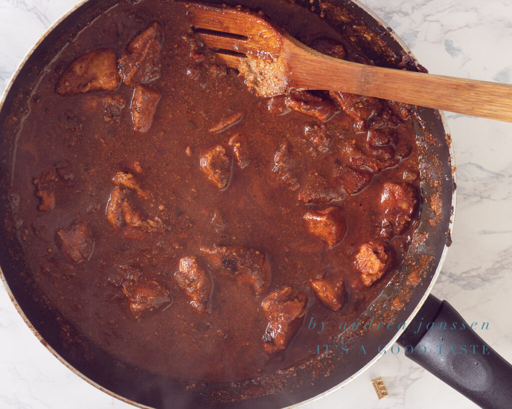 Add tomato paste to chicken masala