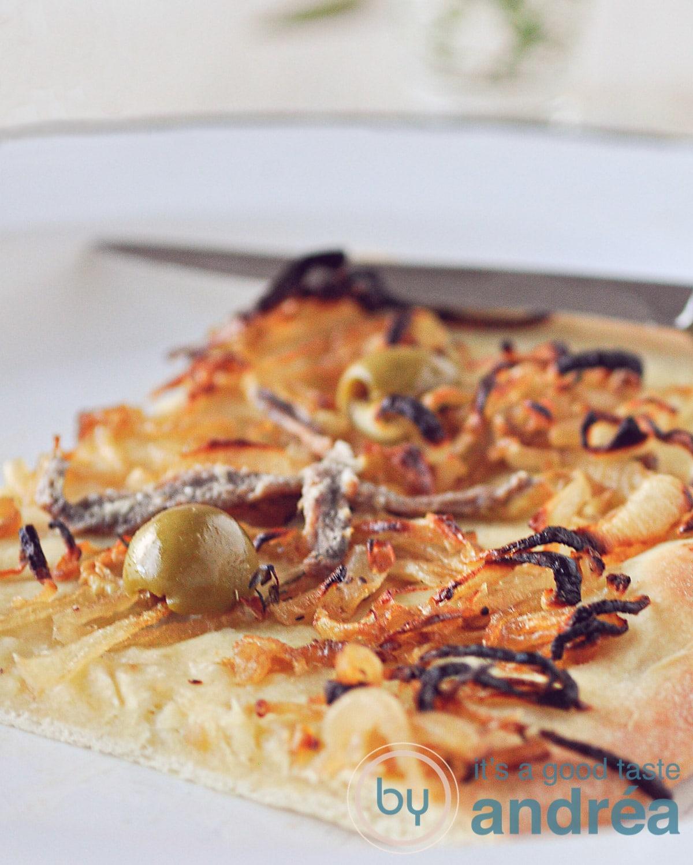 a piece of Pissaladière on a plate