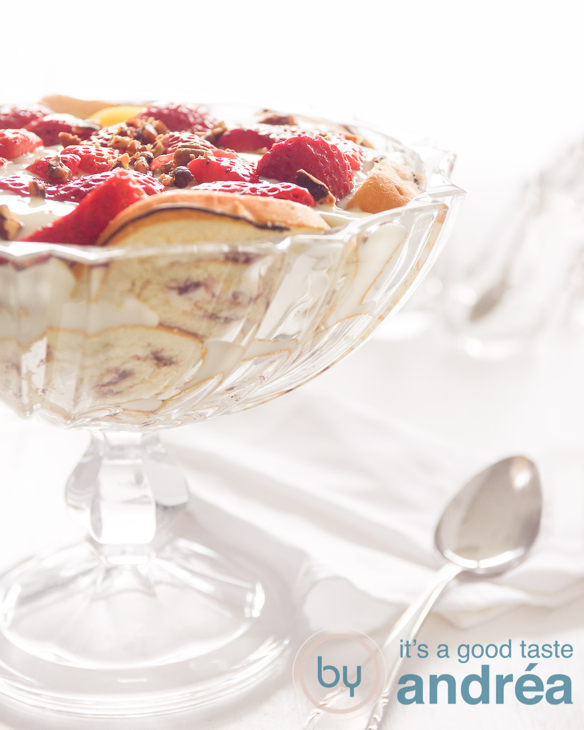 a bowl with strawberry trifle