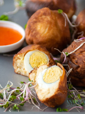 African Egg balls on a plate with sweet chili sauce