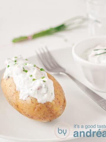baked potato with herbed cottage cheese on a plate