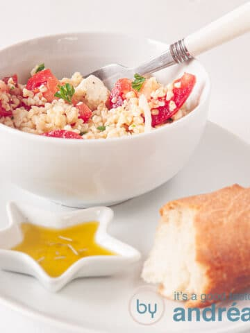 A bowl with bulgur salad, a baguette and herb oil