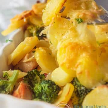 Chicken, bacon, broccoli and potato casserole in a white casserole dish