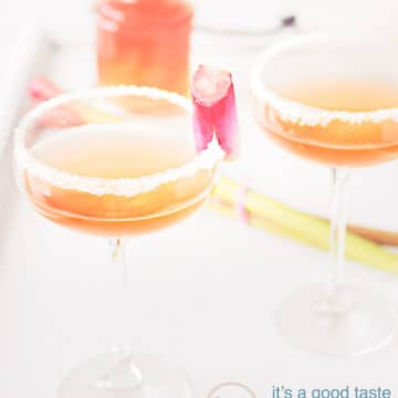 two glasses Rhubarb champagne cocktail with rhubarb syrup in the background