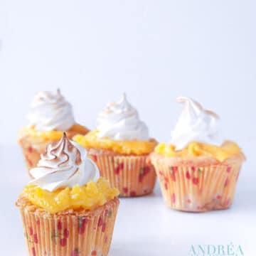 4 Lemon meringue cupcakes on a white plate