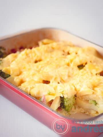 Chicken and broccoli casserole in a red casserole dish