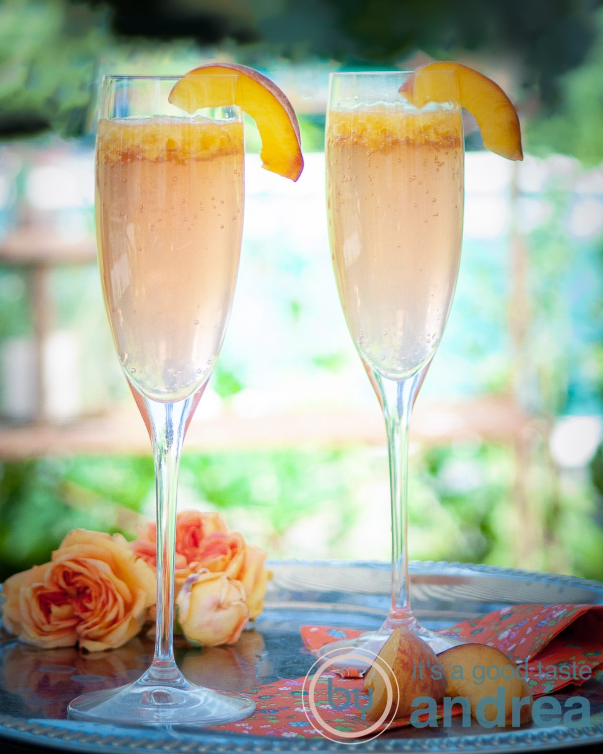 two glasses with Bellini cocktail and slices fresh peach