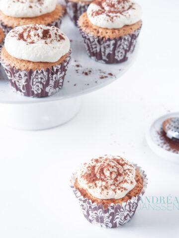 A tart plate with Tiramisu cupcakes and cocoa