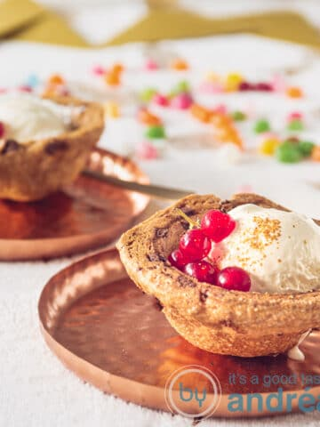 2 cookie baskets filled with vanilla ice cream and red berries