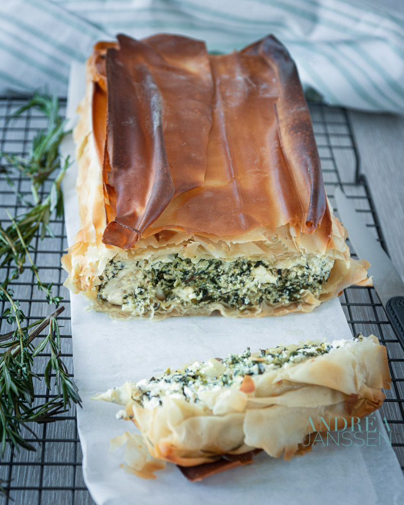 Spinach ricotta and feta cake on a baking paper and rack