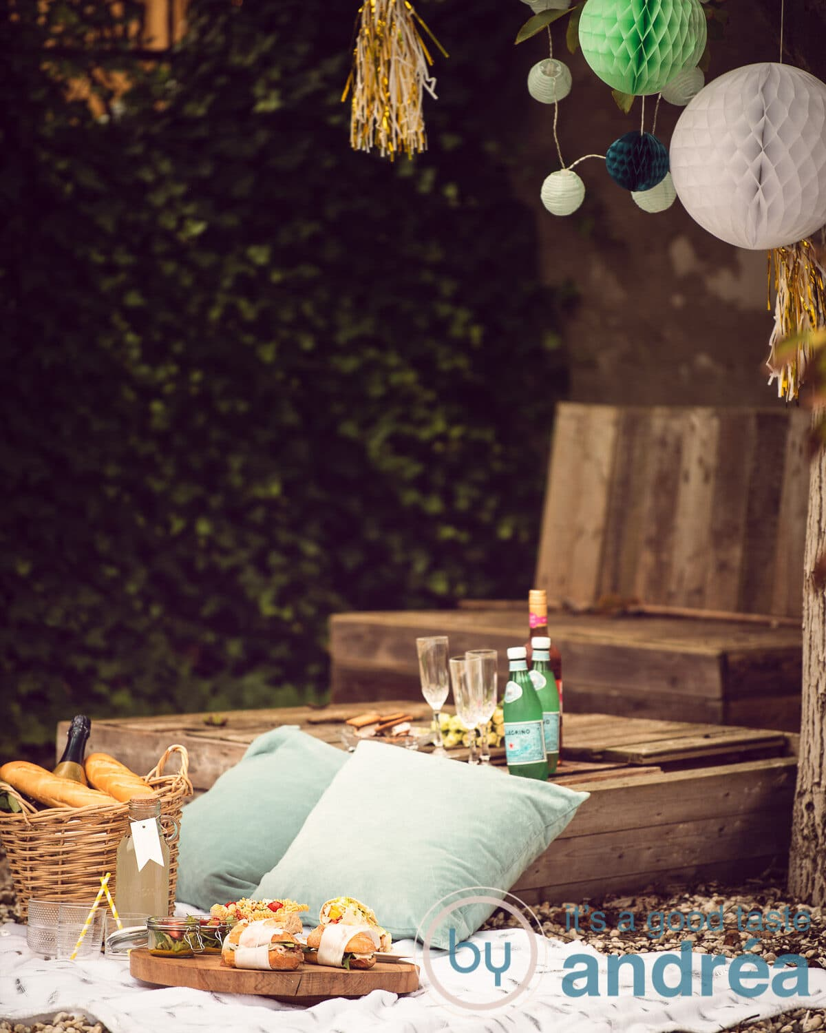 A summer picnic with drinks and food on a white plaid