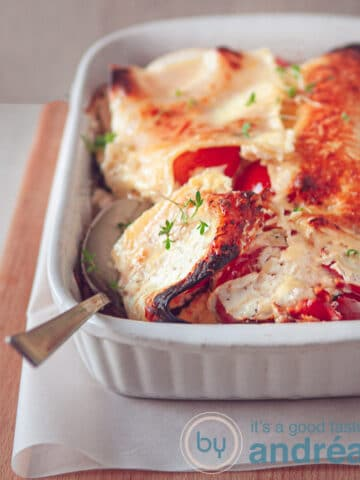 a vegetarian lasagna casserole with a spoon full taken