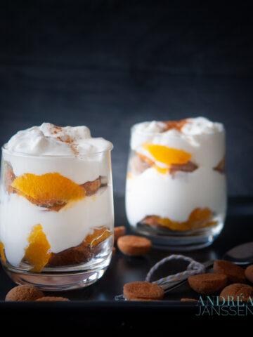 two glasses of pepernoten tangerine tiramisu in between pepernoten