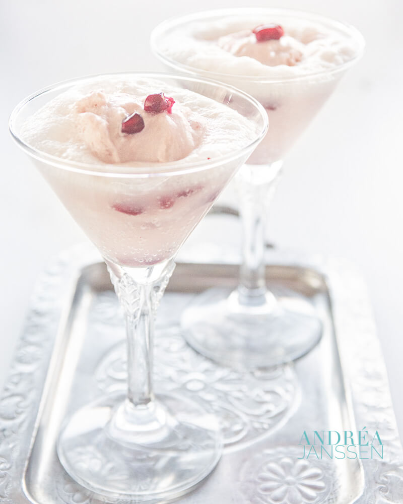 Two glasses of Spoom with pomegranate yogurt ice and prosecco on a silver tray
