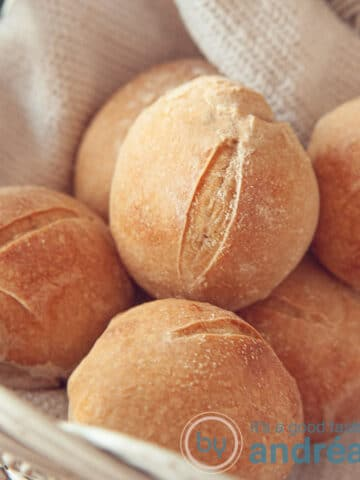 A bowl with homemade rye whole wheat buns