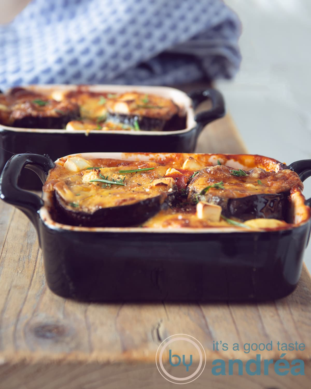 two one person casserole dishes filled with moussaka