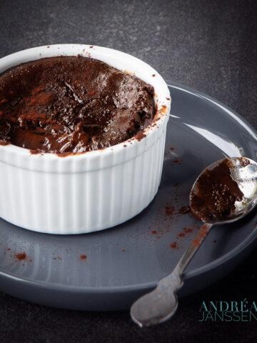 a ramekin with a chocolate pudding with a liquid heart