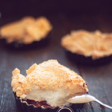 three quiche forms filled with sweet rhubarb stew and topped with a caramelized foam.