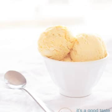 a white bowl with three scoops of Cognac ice cream and a spoon