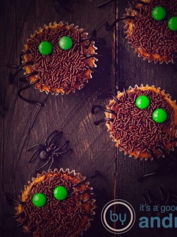 a square photo of 2 whole spider cupcakes and 2 half spider cupcakes