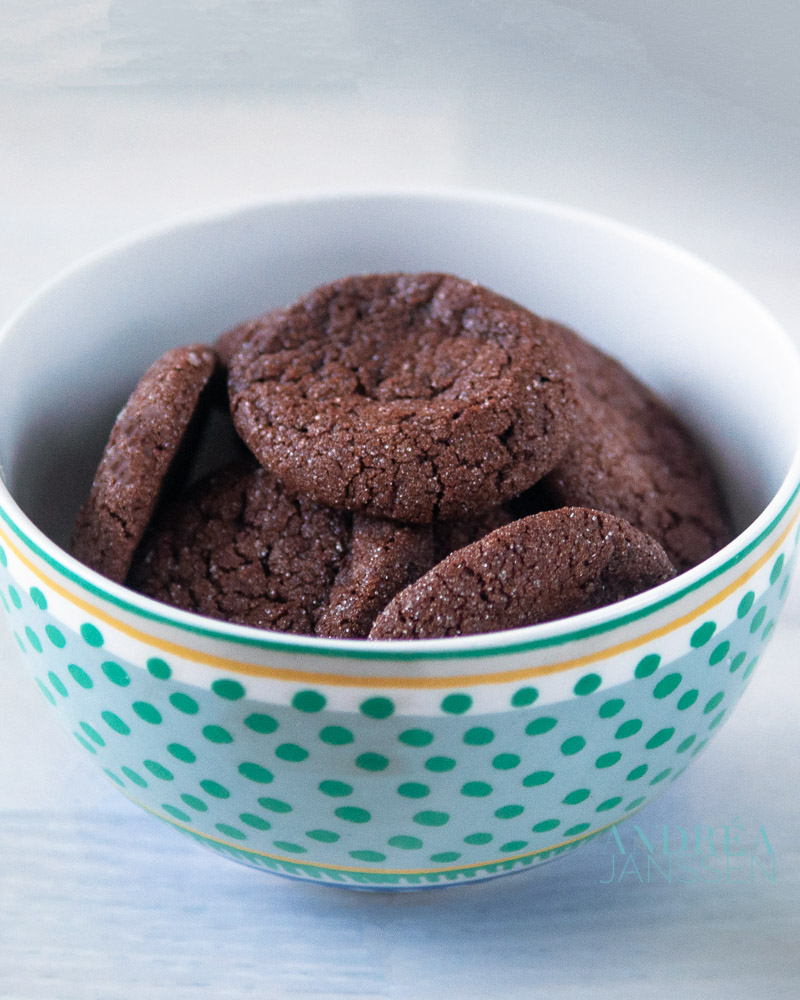 a bowl filled with chocolate cookies