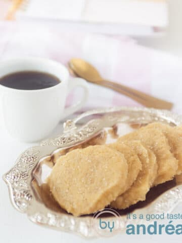 Ginger cookies on plate with cup of coffee