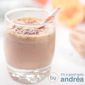 square photo of a smoothie in a glass with a orange white straw