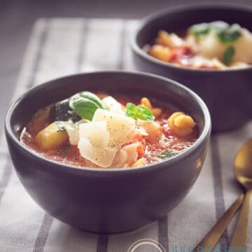 two cups of Filled minestrone soup with pasta
