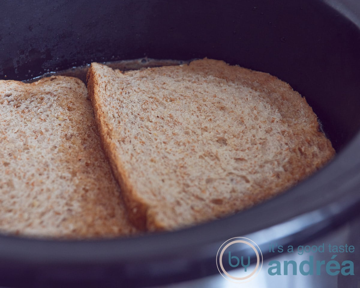 two slices of bread in the slowcooker