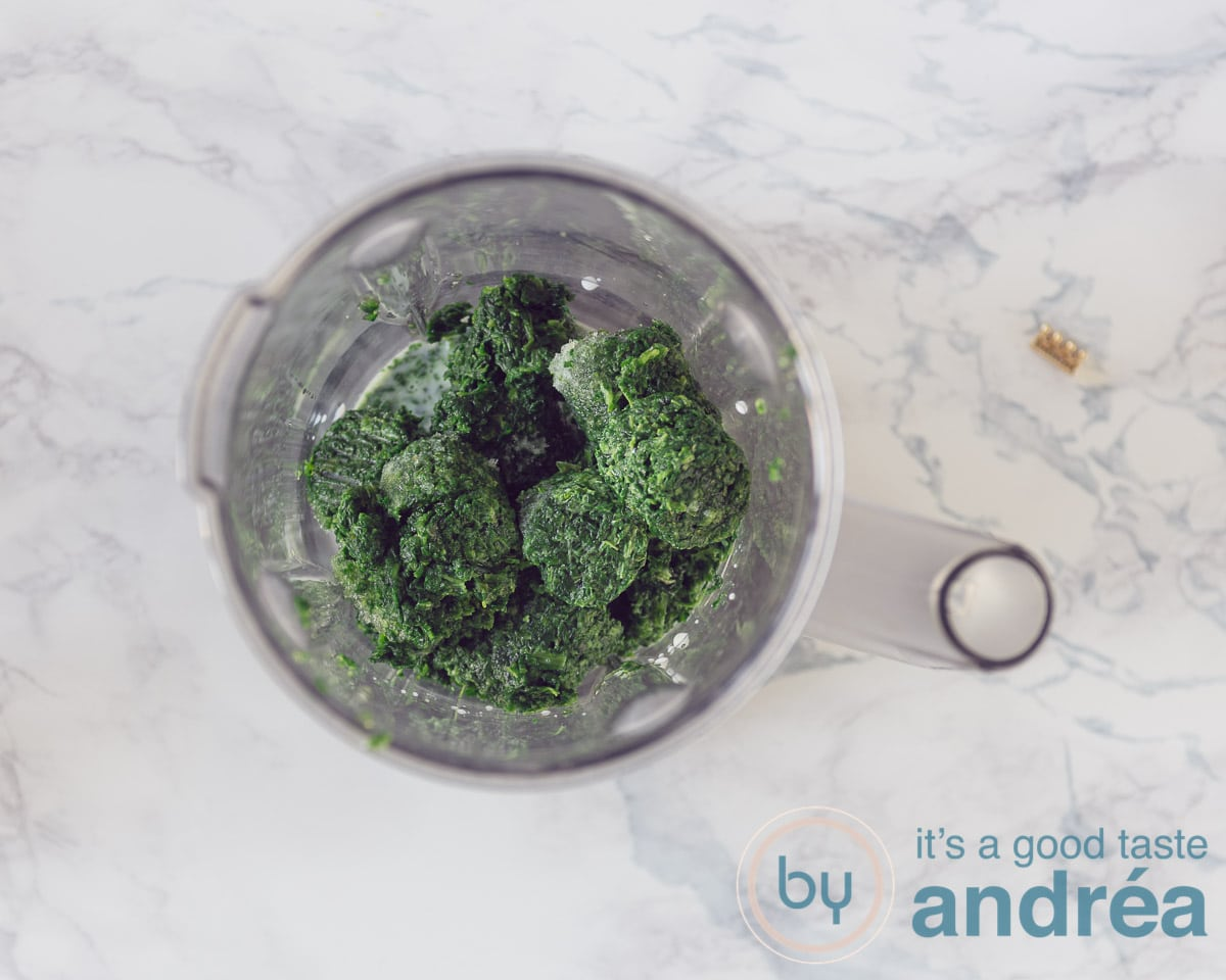 Spinach and milk in a blender