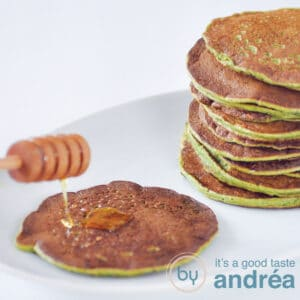 a square photo with pancakes filled with spinach. A pancake is topped with honey