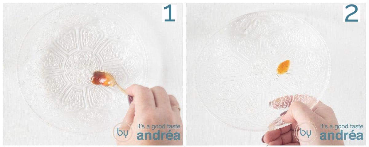 Een glazen bord met een druppel jam en op de kant gehouden