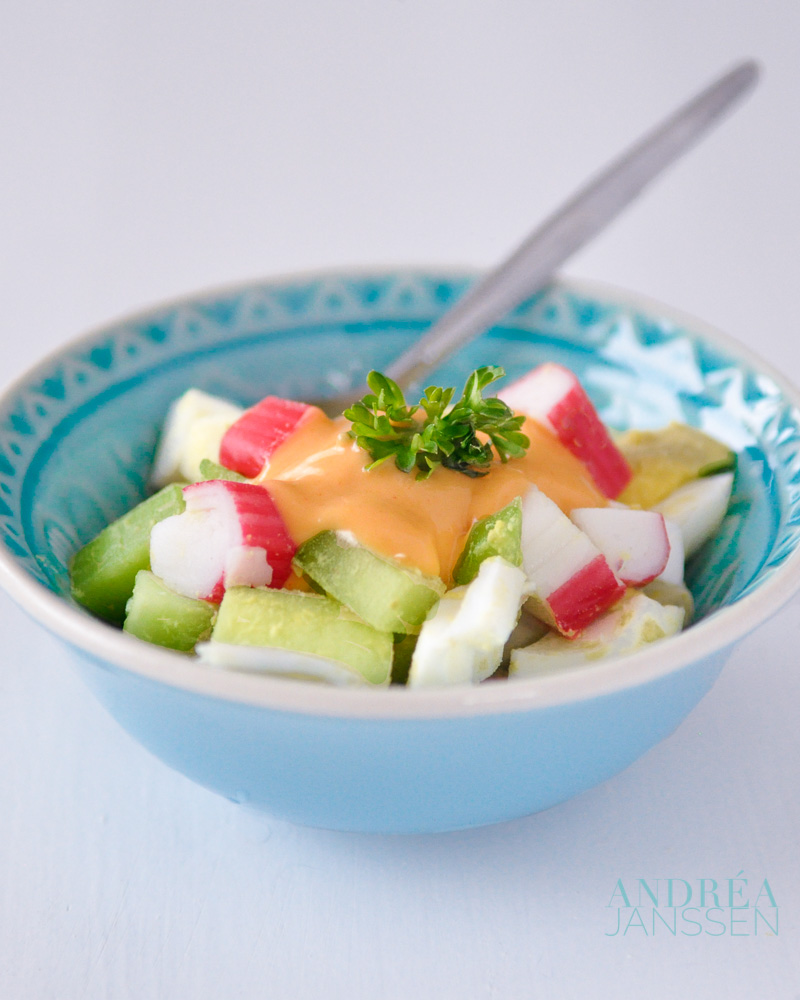 a bowl with surimi salad with homemade cocktail sauce