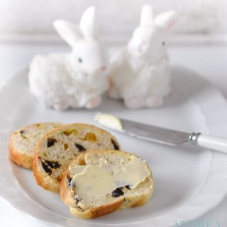 slices Easter stollen with orange and cinnamon on a white plate