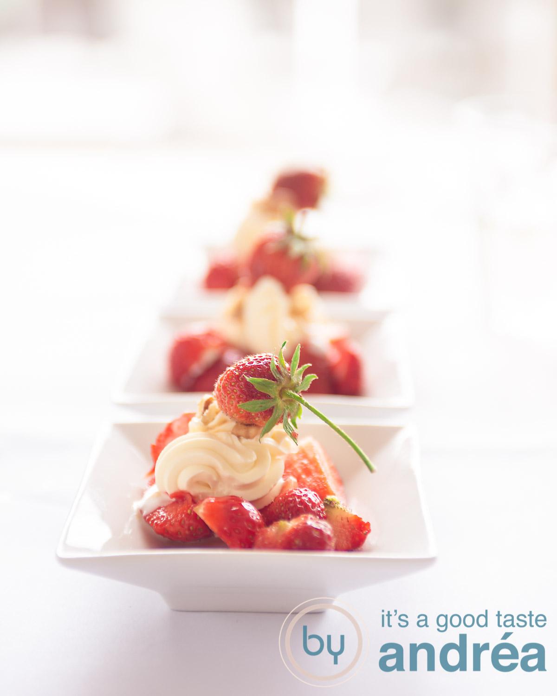 three white plates with fresh strawberries and cream