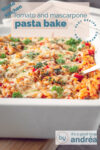 a white casserole dish filled with Mac and cheese with mascarpone tomato sauce