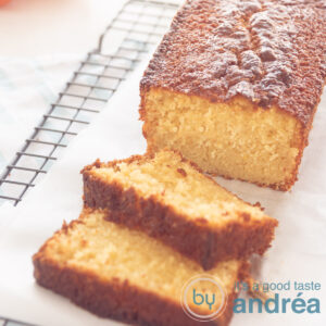 tangerine cake in a cake tin. Two slices in front and some tangerine parts