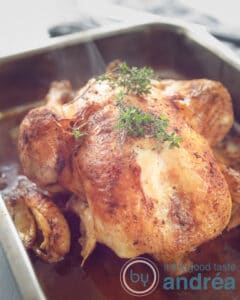 whole chicken slowcooker rotisserie style in a baking dish