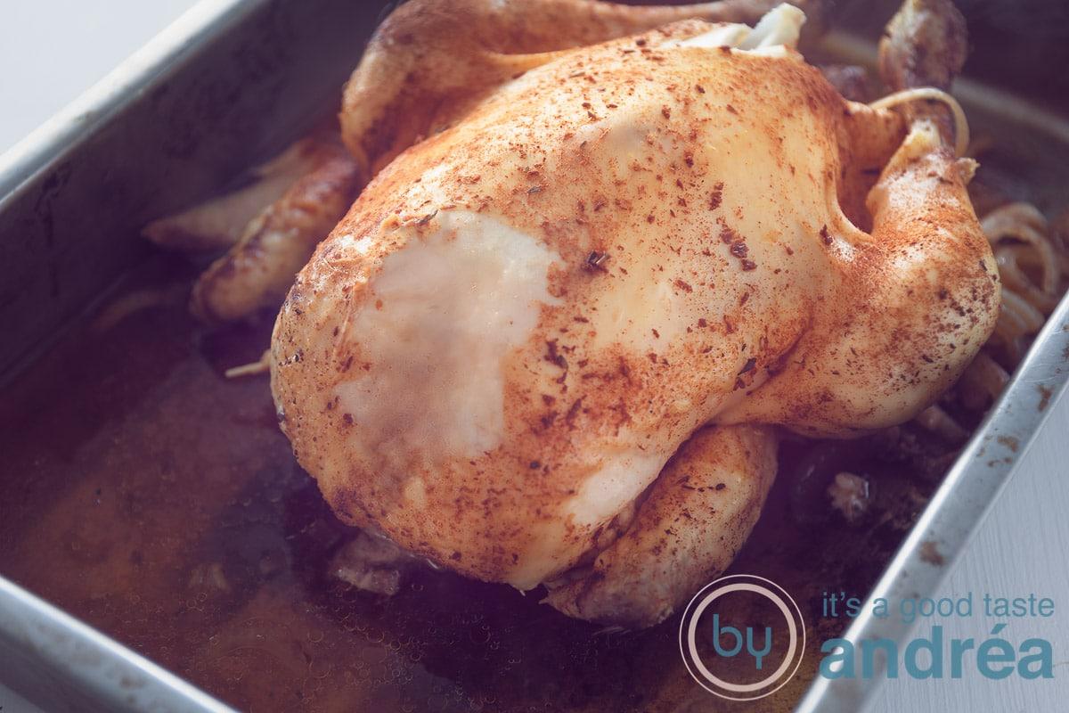 whole chicken in a casserole dish
